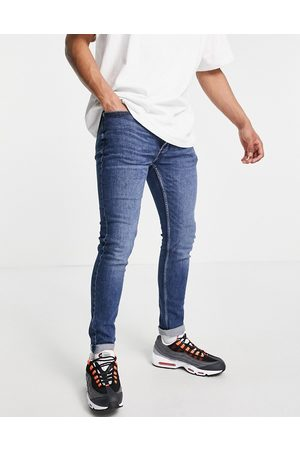 Topman Organic cotton blend stretch skinny jeans in mid wash