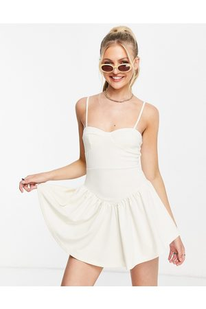 ASOS DESIGN Strappy mini cupped detail dress in cream