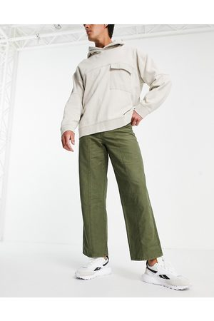 ASOS DESIGN Wide fit trousers in heavy wash in khaki