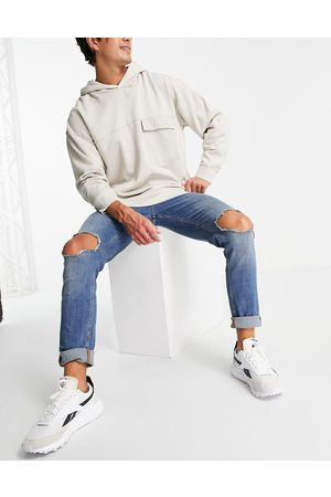 ASOS DESIGN Men Skinny - Skinny jeans in tinted mid wash with knee rips