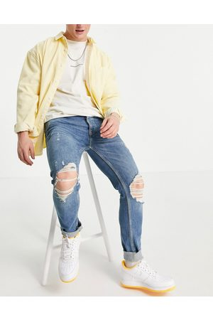 Topman Organic cotton blend stretch skinny jeans with rips in mid wash