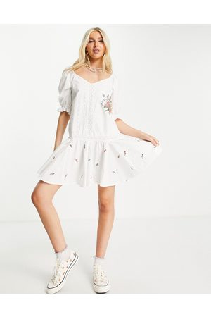 ASOS DESIGN Embroidered cotton mini smock dress with lace trims and pephem in