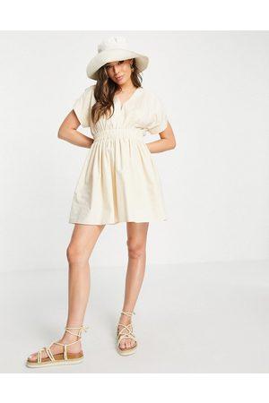 ASOS DESIGN Cotton poplin gathered waist mini dress in -Neutral