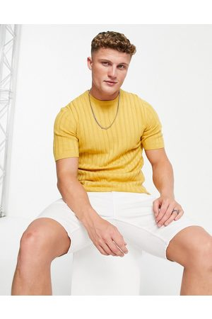 ASOS DESIGN Muscle fit ribbed t-shirt in mustard