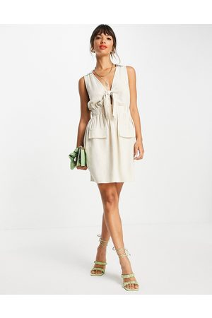 ASOS DESIGN Linen sleeveless knot front mini dress in natural-Neutral