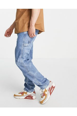 Levis Levi's tapered fit carpenter jeans in mid wash