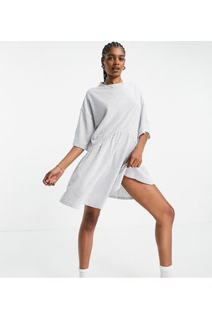 ASOS DESIGN Tall oversized mini smock dress with dropped waist in navy and white stripe