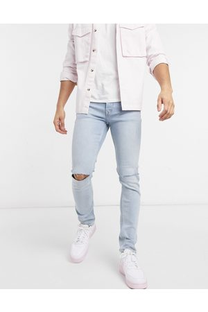 Topman Men Skinny - Organic cotton blend stretch skinny jeans with knee rips in bleach wash