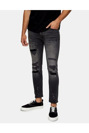 Topman Organic cotton blend stretch skinny ripped and repaired paint jeans in washed