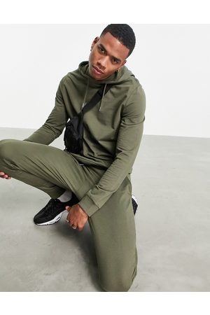 ASOS DESIGN Organic lightweight tracksuit with hoodie & skinny joggers in