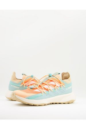 adidas Adidas Outdoors Terrex Voyager trainers in mint and orange