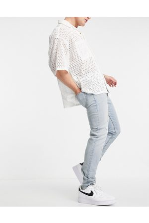 ASOS DESIGN Cone Mill Denim skinny fit 'American classic' jeans in vintage light wash with rips