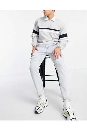ASOS DESIGN Men Slim - Stretch slim jeans in 90's bleach wash with rips