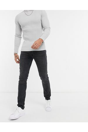 Topman Organic cotton blend stretch skinny jeans with raw hem in washed