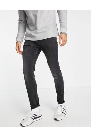 Topman Organic cotton blend stretch skinny jeans in washed black