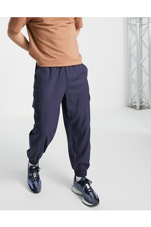 ASOS DESIGN Linen mix oversized tapered trousers with cargo pockets in navy