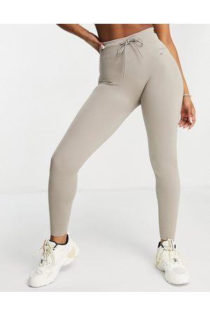 Reebok Ribbed logo leggings with drawstring waist in beige