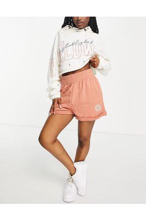 Nike Women Sports Bras - High rise shorts in tan