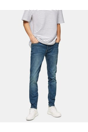 Topman Organic cotton blend skinny jeans in mid wash