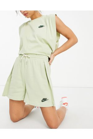 Nike Earth day mid rise fleece shorts in olive