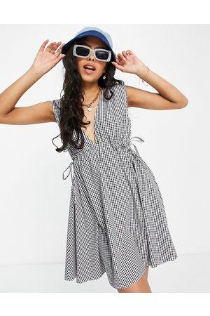 ASOS DESIGN Plunge mini sundress with ruched waist in seersucker gingham-Multi
