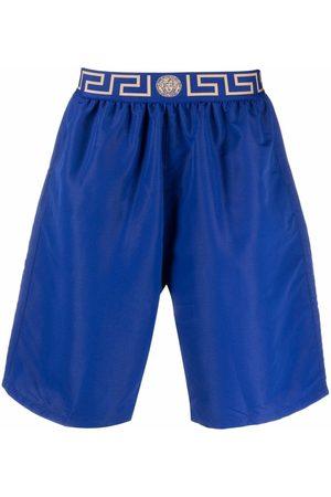 VERSACE Men Swim Shorts - Greca-trim swim shorts