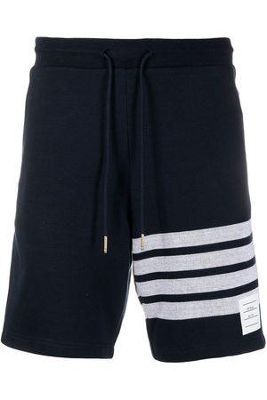 Thom Browne Men Sports Shorts - 4-Bar stripe shorts