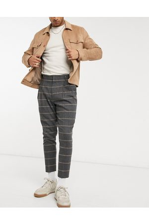 ASOS Tapered cropped double pleat smart trousers in wool mix check