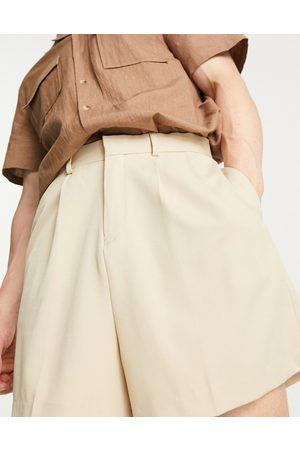 ASOS DESIGN Cropped bermuda shorts in stone-Neutral