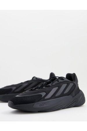 adidas Ozelia trainers in triple