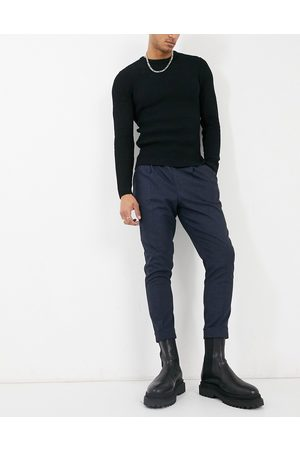 ASOS DESIGN Men Chinos - Tapered wool mix smart trousers in dog tooth with turn up-Navy