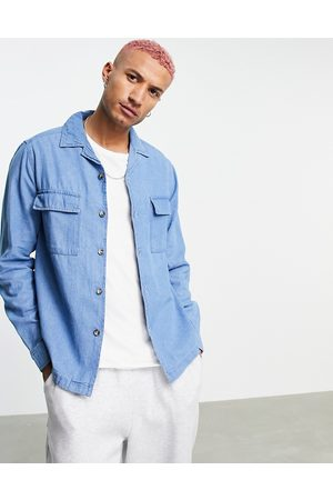 ASOS Denim overshirt in mid wash with revere collar