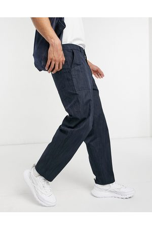ASOS DESIGN Carpenter trousers in wide fit in texture fabric-Navy