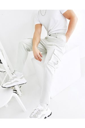 ASOS DESIGN Men Cargo Pants - Tapered smart trousers with cargo pockets in light