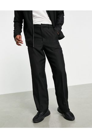 ASOS Men Chinos - Smart wide leg trousers with leopard jacquard in black