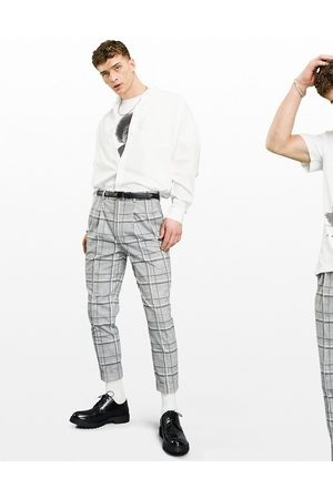 ASOS Tapered wool mix smart trousers in check with turn up