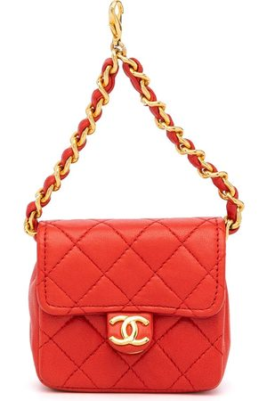 CHANEL Women Wallets - Mini diamond-quilted flap pouch