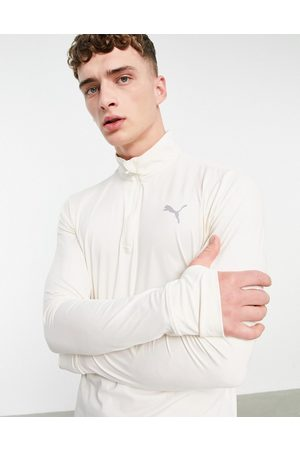 PUMA Running Favourite quarter zip sweatshirt in cream