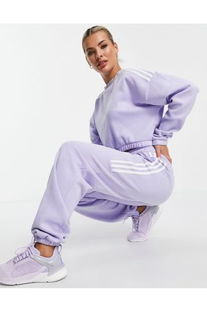 adidas Adidas Training oversized joggers with three stripes in lilac