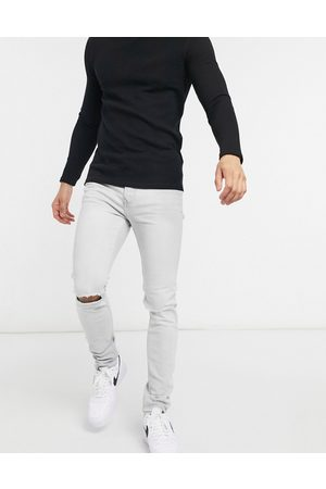 Topman Organic cotton blend knee ripped skinny jeans in