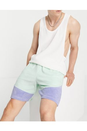 ASOS DESIGN Co-ord oversized towelling colour block shorts in blue
