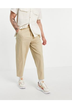 ASOS DESIGN Oversized tapered chinos in -Neutral