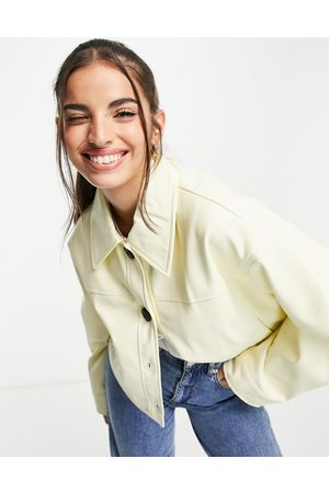 ASOS DESIGN Cropped faux leather jacket in buttermilk