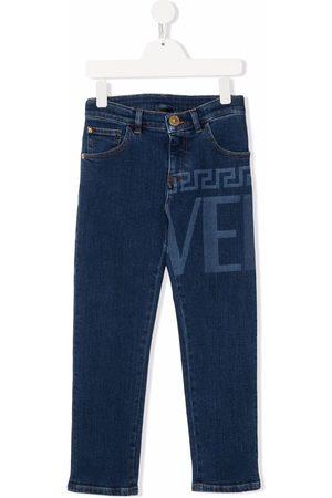 VERSACE Logo-print skinny jeans