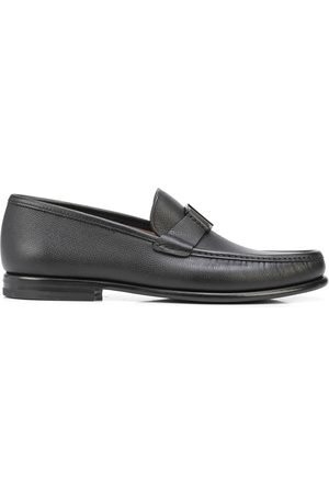 Salvatore Ferragamo Logo-engraved leather loafers