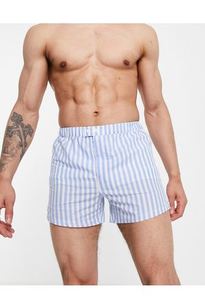 ASOS DESIGN Woven boxer in blue stripe with button fastening