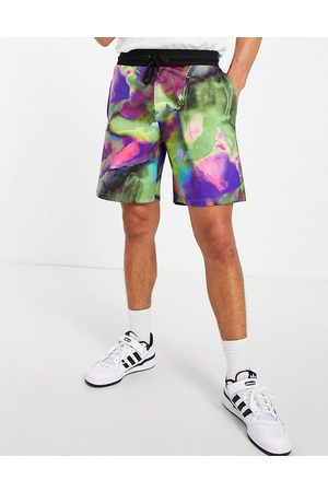 ASOS DESIGN Men Sets - Co-ord festival relaxed shorts in all over print-Multi