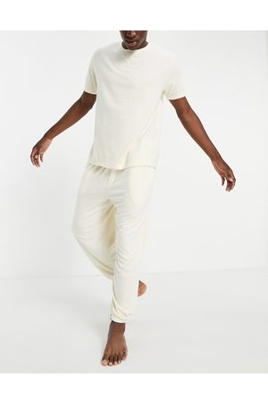 ASOS DESIGN Fluffy pyjama set with oversized jogger and t-shirt in -Neutral