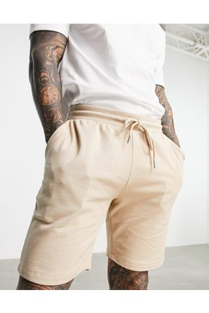 ASOS Co-ord oversized jersey shorts in -Neutral
