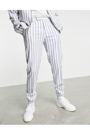 ASOS DESIGN Co-ord slim smart jogger in and blue stripe